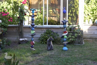 Russian blue cat with totem pole