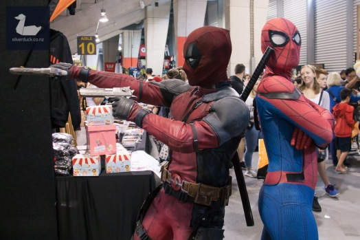 Deadpool cosplay by Wellington Deadpool and Spiderman cosplay by RiverFish. Wellington Armageddon Expo 2018. Photo by Silver Duck.
